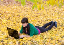 Free Young Girl With A Laptop In A Autumn Foliage Stock Photo - 20359140