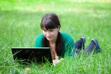Free Beautiful Girl Lying In The Grass With Laptop Stock Photo - 20359220