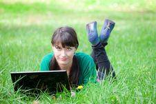 Free Beautiful Girl Lying In The Grass With Laptop Royalty Free Stock Photography - 20359237