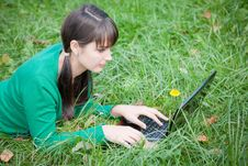 Free Beautiful Girl Lying In The Grass With Laptop Stock Photography - 20359262