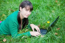 Free Beautiful Girl Lying In The Grass With Laptop Royalty Free Stock Image - 20359276