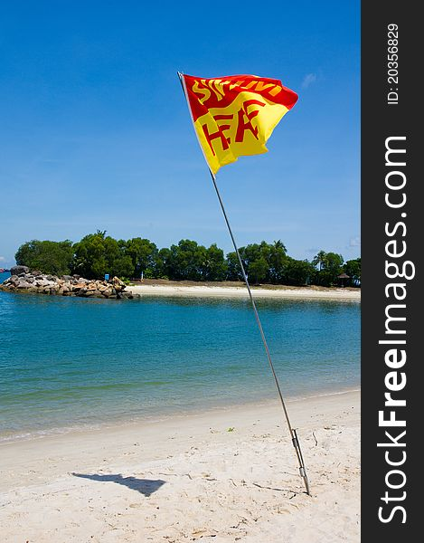 Swim Here Flag on Beach