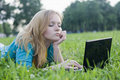 Free Pretty Woman With Laptop On The Green Grass Royalty Free Stock Images - 20360849