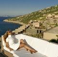Free Beautiful Woman Relax On The White Sofa Near Coast Stock Image - 20362061