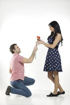 Romantic Boy Giving Rose To His Girlfriend Royalty Free Stock Image