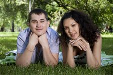 Free Couple Lays Together On A Grass Stock Images - 20360364