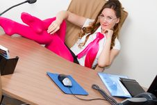 Free Beautiful Business Woman In A Pink Tie At The Tabl Stock Photography - 20360932