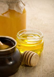 Honey In Jars And Pot On Wood Stock Image