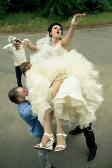 Free Bbride Tossed By A Group Of Groomsmen Stock Photography - 20363002