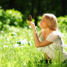 Free Woman Playing With A Butterfly Royalty Free Stock Photos - 20365738