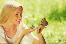 Free Woman Playing With A Butterfly Royalty Free Stock Image - 20365746