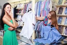 Girl Seller Helps Shoppers Royalty Free Stock Photography