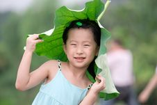 Free Chinese Girl With Lotus Leaf Hat Royalty Free Stock Photography - 20366117