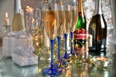Free Champagne In Glasses, Gift Boxes And Lights Stock Photography - 20366682