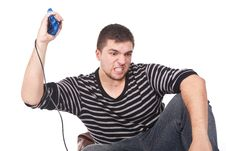 Furious Man With A Joystick For Game Console Royalty Free Stock Photo