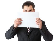 A Businessman Is Holding A Blank Sheet Of Paper Royalty Free Stock Photo