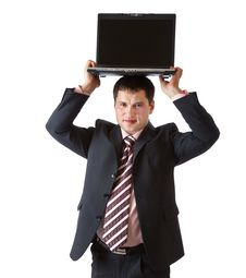 Free A Businessman Is Holding The Laptop Above His Head Royalty Free Stock Images - 20377149
