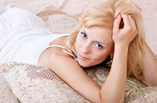 A Woman Is Lying On Pillows Royalty Free Stock Images