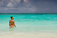 Free Tanned Girls Is Standing In Bright Blue Ocean Stock Photo - 20379190
