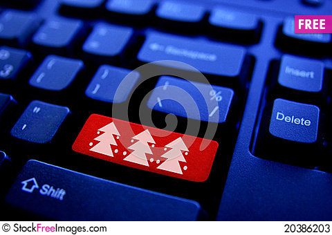 Free Christmas Tree On Computer Key Stock Photos - 20386203
