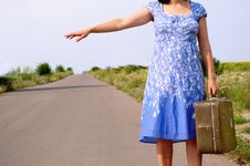 Free Young Girl On The Road With A Suitcase Stock Photo - 20380600