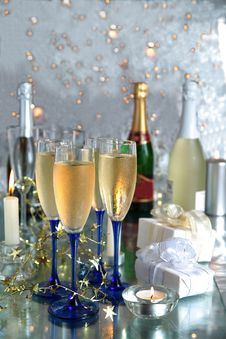 Free Champagne In Glasses,bottles, Gifts And Lights Royalty Free Stock Photo - 20381685
