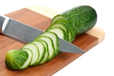 Free Green Cucumber With Knife Stock Image - 20383891