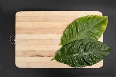Leaves Into Wood Plates Stock Photo