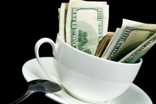 Free White Cup Full Of Dollars Royalty Free Stock Images - 20385509