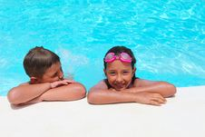 Free Girl And Boy Relaxing Near  Swimming Pool Royalty Free Stock Images - 20386619