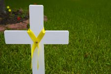 White Cross With Yellow Ribbon Stock Photography