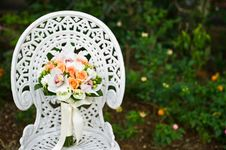 Free Wedding Flower Bouquet On A White Garden Chair Stock Image - 20389041