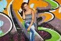 Free Girl Near Graffiti Wall Background. Stock Photo - 20394490
