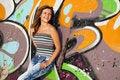 Free Girl Near Graffiti Wall Background. Royalty Free Stock Photography - 20394507