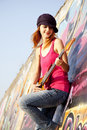 Free Girl With Guitar And Graffiti Wall Royalty Free Stock Photography - 20394787