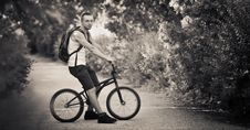 Free Young Man On Bike Royalty Free Stock Photo - 20390775