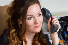 Free Curly Secretary With A Telephone Receiver Royalty Free Stock Images - 20392079