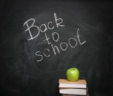 Free Apple On Books Against Blackboard Stock Photo - 20393110