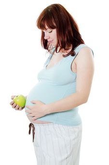 The Pregnant Woman With An Apple Royalty Free Stock Images