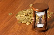 Free Hourglasses And Coin On Wooden Table Stock Photography - 20394112