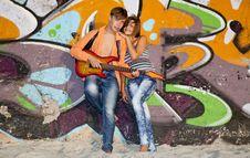 Free Couple With Guitar Near Graffiti Wall. Royalty Free Stock Photos - 20394508