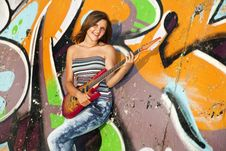 Free Girl With Guitar And Graffiti Wall Stock Image - 20394551