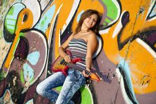Free Girl With Guitar And Graffiti Wall Royalty Free Stock Photo - 20394555