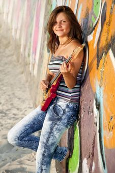 Free Girl With Guitar And Graffiti Wall Stock Photography - 20394562