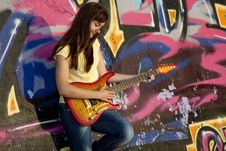Free Girl With Guitar And Graffiti Wall Royalty Free Stock Image - 20394566