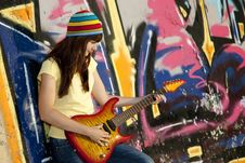 Free Girl With Guitar And Graffiti Wall Royalty Free Stock Images - 20394599