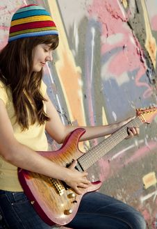 Free Girl With Guitar And Graffiti Wall Royalty Free Stock Photos - 20394608