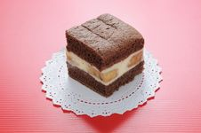 Chocolate Softcake With Banana On Red Background Royalty Free Stock Photos