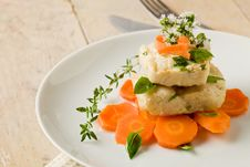 Free Cod On Carrot Bed With Fresh Oregano And Basil Stock Image - 20397241