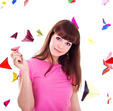 Young Woman Holding Paper Airplane Stock Photo